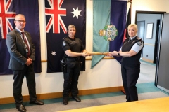 The-Queensland-Baton-is-handed-over-to-Sergeant-Braydon-Murphy-with-Commissioner-Katarina-Carroll-and-union-President-Ian-Leavers